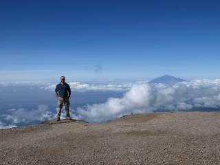 Cú Chullain on Kilimanjaro with Mt Meru in the background