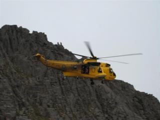 Rescue chopper on excersise, top of fingers ridge behind