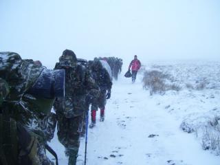 Ten Tors Training group being lead of little mis tor, Dartmoor