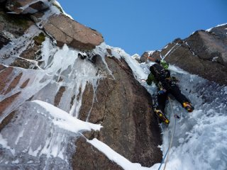 Mark questing up the steep corner on Sticil Face.