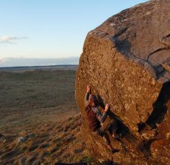 Pulling on the crimps of NW Wall as the April sun goes down.