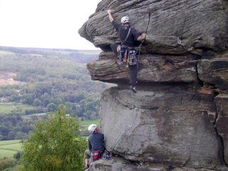 Bryan leads the top pitch of Valkyrie (HVS 5a)at Froggatt Edge, Derbyshire. Andy waits to follow!