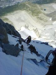 Climbing the ice pitches to the left of the rognon on the Frendo Spur. Lac Blue below and Chamonix even further down.