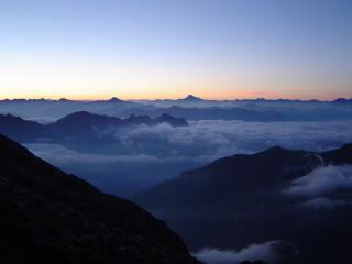 Sun rising on summit day Mt Pelvoux - Ecrins - France
