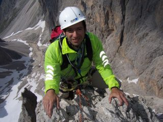 Me on the Thumb, Dolomites (Sella area) complete with wonky helmet. Superb route, horrible descent