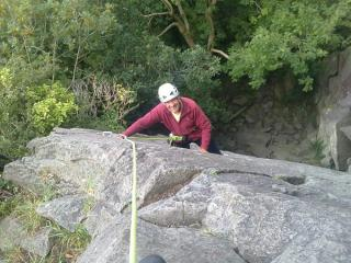 John nearing the top of the first pitch.