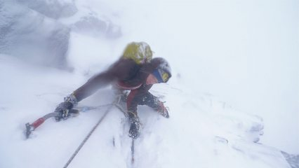 Wintery weather and lens fog on White Magic, Cairngorms. Steve Dunning just exiting the Magic Crack.