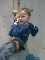 Start em young. My son getting lowered after completing his first ascent aged 4. And he got to the top!!!