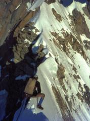 A cheval on a snow arete low on the Innominata route, Mont Blanc