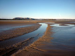 Whitbarrow and the Lakes fells from the Kent estuary