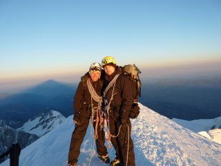Me and the old man on the summit of Mont Blanc as the sun rises.