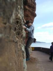Charlie Birkett on the low traverse, Sidmouth