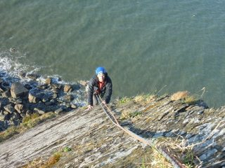 Andy on the exposed arete of The Verger