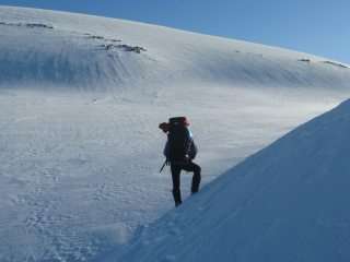 Utter Desolation below Ben MacDui and above Loch Etchachan. Iain taking it all in before digging a home for the night.