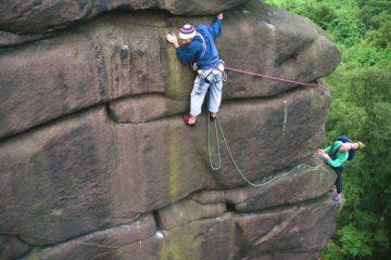 Teamwork on the crux of Promontory Traverse (E2 5b), Black Rocks, Peak District