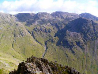 Climbers dwarfed by the mountain scenery