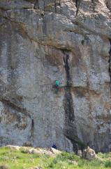 Technical start leads to easier climbing off flake and bouldery finish. Crux up top