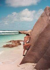 some japanese chick bouldering, La Digue, Seychelles