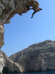 Nico Borchers deep water soloing at the Blue Grotto, Malta