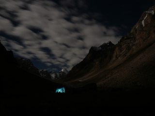 Base camp at night, with the attempted spur visible high on the right.