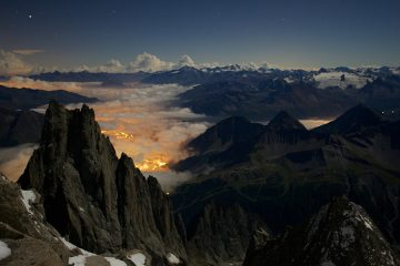 Full moon shines over Aig Noire de Peuterey and Courmayeur