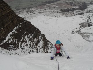Cally topping out her first winter climb!
