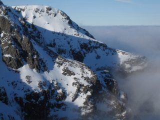 Upper reaches of Ledge Route above the clouds in inversion conditions (as seen from Tower Ridge).