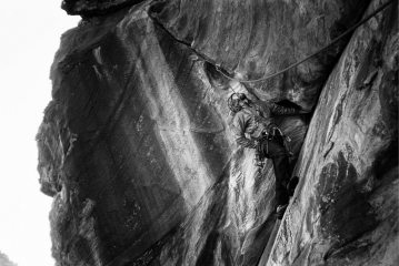 Mike Goodhue, looking up into the crux roof of Spectrum (5.11a R, sandbag at that!), Pine Creek Canyon, Red Rocks.