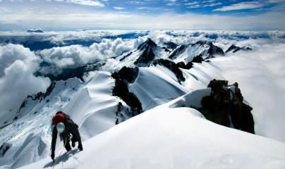 Darrin Fast of the BCMC approaching the summit of Dione via the South West Face (AD). Tantalus Range, British Columbia.