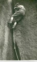 This was taken in 1961 and shows Peter Maddocks on Blue Lights Crack on Wimberry Rocks, Chew valley.