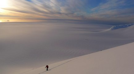 Starting the night ascent of Mt Agamemnon with view over the Marr Ice Piedmont, Anvers Island. Antarctic Peninsula
