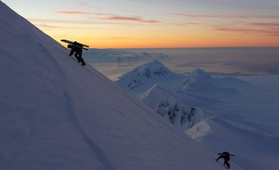Ascending Mt Agamemnon at sunset, Anvers Island. Mt William and Lemaire Channel area behind
