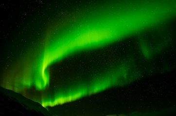 Aurora Borealis above the mountains of the Abisko national park, Sweden.