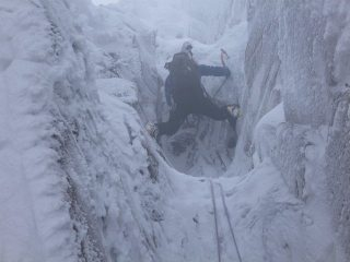 Paul Figg on the surmounting the ice steps of Sinister Prong.