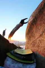 Tom Greenall committing to the lob across Big Air at Stanage.  Still enough snow to make it safe-ish!