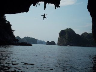 Vu taking the plunge off a 7c+, Ha Long Bay