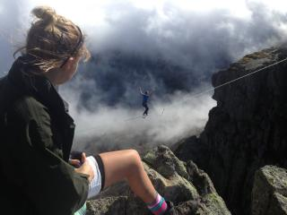 Slackliner on Tryfan, Snowdonia, watched by Annabel.