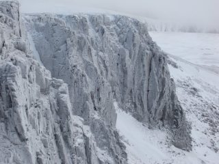 Climbers on Ewen Buttress, Deep Throat and Savage Slit