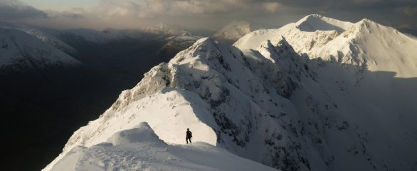 Chris approaching the pinnacles of the Aonach Eagach ridge, in spectacular winter condition.