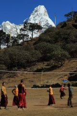 Surreal, monks playing volleyball at Tengboche with Ama Dablam in background