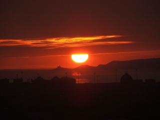 Sunset over Mumbles lighthouse