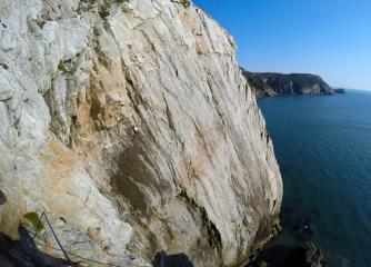 Mike spanned out on the airy exposed traverse