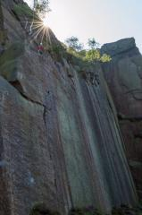 A climber at the belay ledge of Embankment Wall.