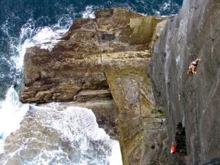 John McCune on a rare ascent of Kerry Gold E4 5c, Valentia Island, Co. Kerry, Ireland.