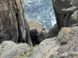 Climber Crossing Chock Stone at Chair Ladder