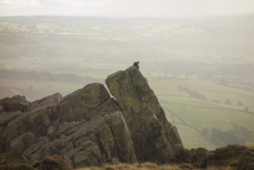 Wrong place, wrong time. A bedraggled climber belaying on top of Valkyrie
