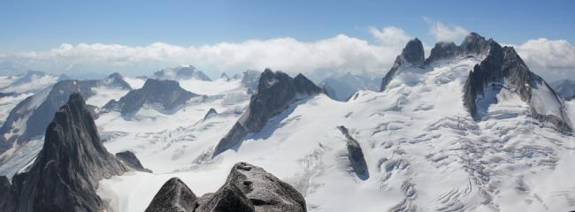 Looking west from Bugaboo Spire Summit towards Pigeon Spire & Howser Towers