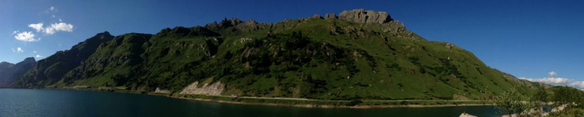 Monte Padon rising above Lago Fedaia, home of Via Ferrata delle Trincee