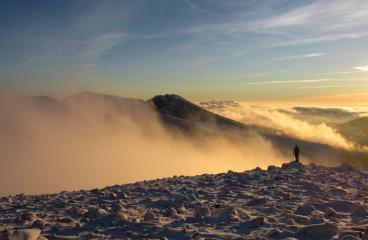 The Scafells seen across the mist from Great Gable.