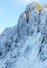 Winter climbing on Reade's Route. Lead climber on P1